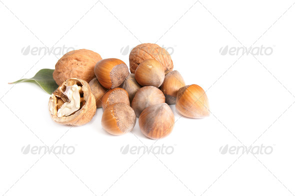 Tasty nuts on a white. - Stock Photo - Images