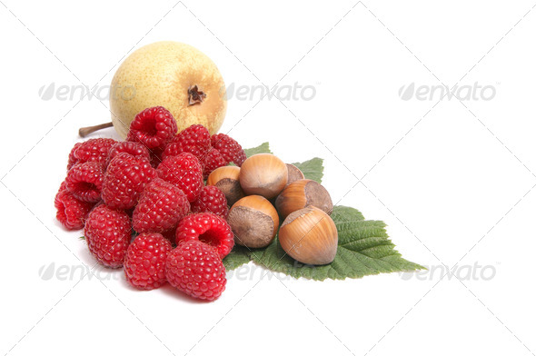 Ripe nuts,pear and raspberries on a white. - Stock Photo - Images