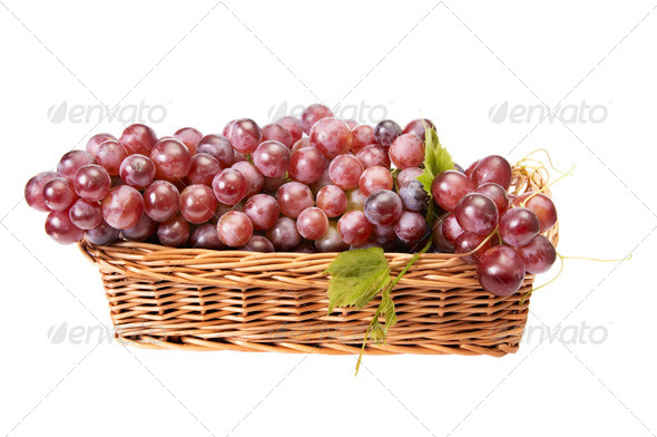 Wooden basket and ripe grapes on a white. - Stock Photo - Images