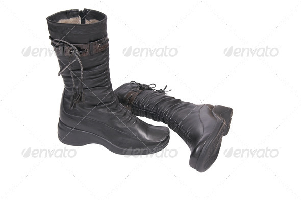 Modern black boots on a white. - Stock Photo - Images