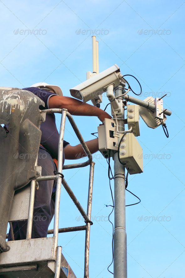 security camera and technician - Stock Photo - Images