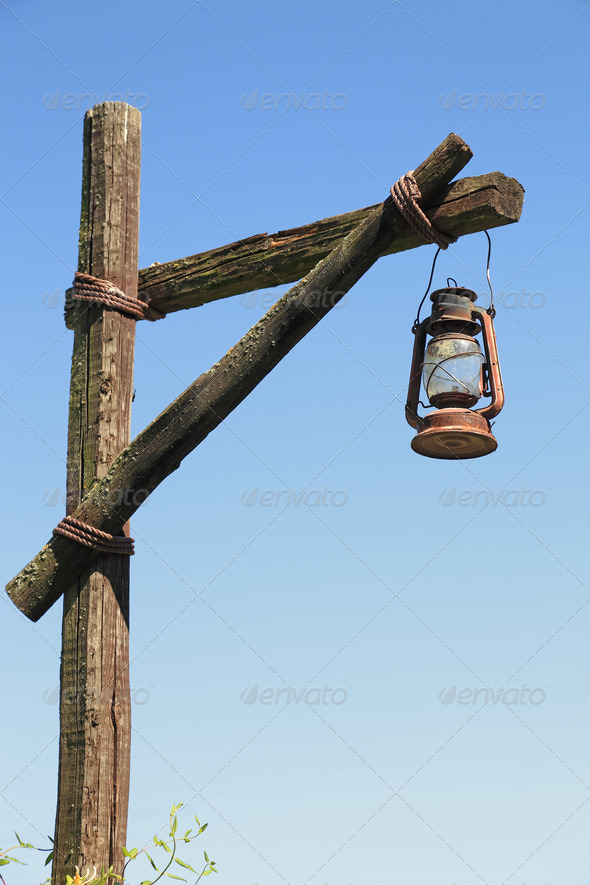oil lamp on wooden post - Stock Photo - Images