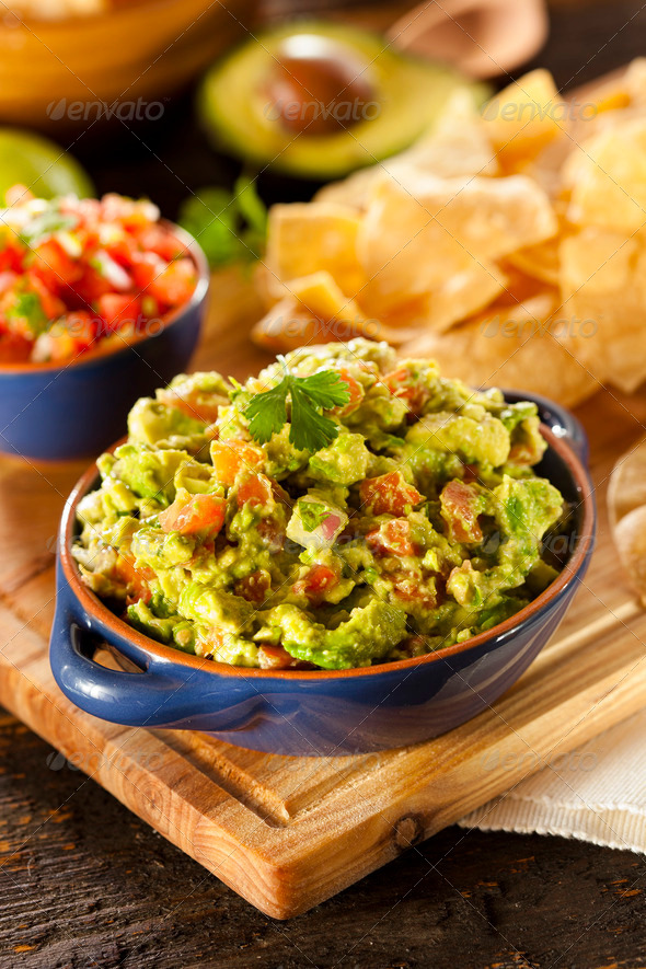 Homemade Organic Guacamole and Tortilla Chips - Stock Photo - Images