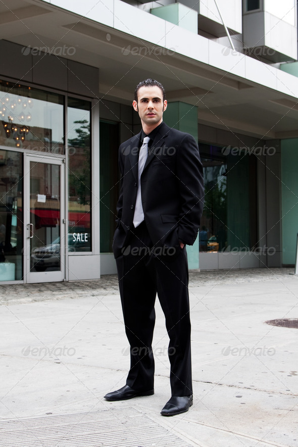 Business man standing - Stock Photo - Images