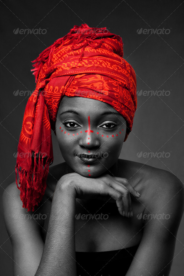 Tribal African woman with headwrap - Stock Photo - Images