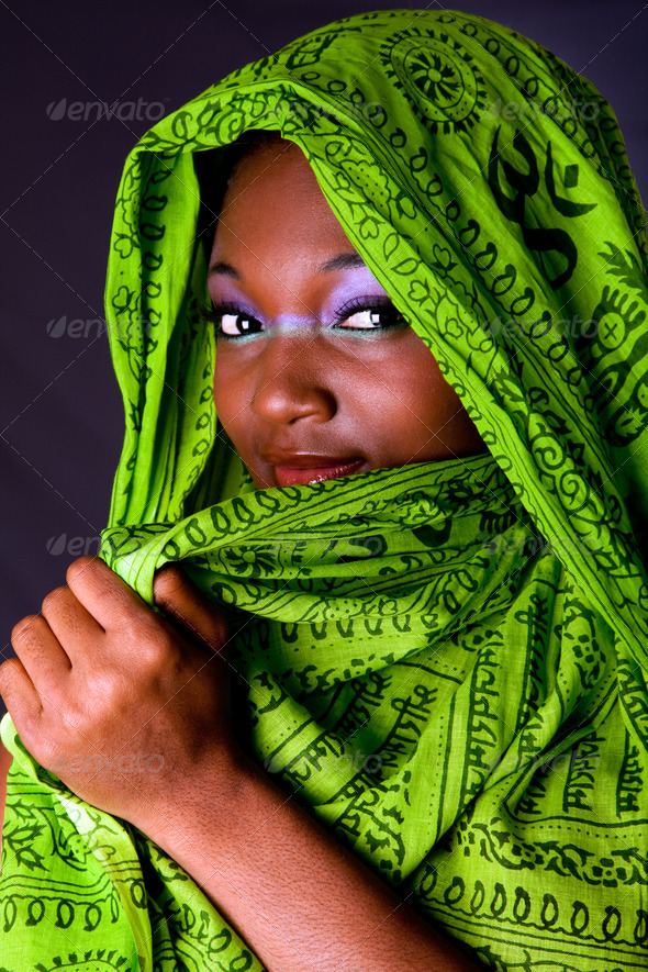 Shy African woman with scarf - Stock Photo - Images