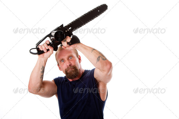 Crazy guy with chainsaw - Stock Photo - Images