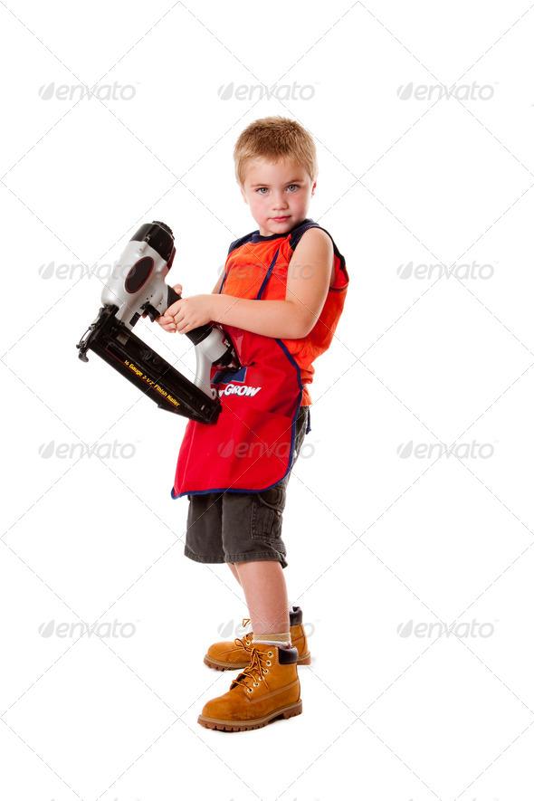 Cute boy with nail gun - Stock Photo - Images
