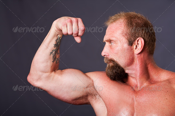 Man showing biceps - Stock Photo - Images