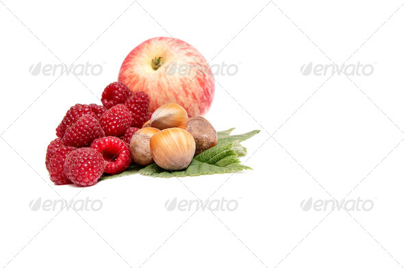Hazelnuts,apple and raspberries on a white. - Stock Photo - Images