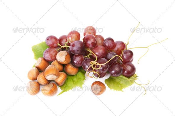 Ripe hazelnuts and  grape on a white. - Stock Photo - Images