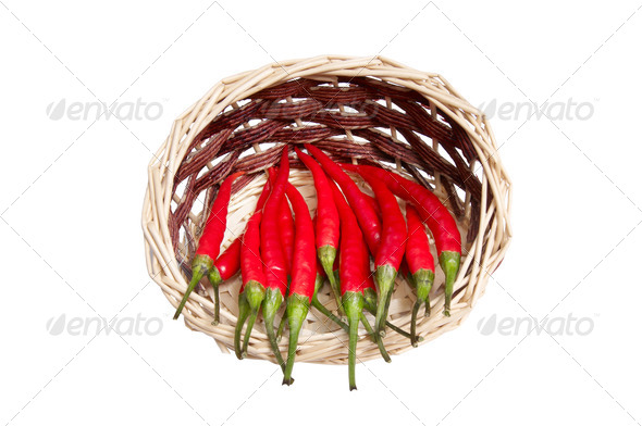 Wooden basket full of red peppers. - Stock Photo - Images