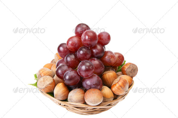 Tasty , ripe hazelnuts and grape isolated on a white background. - Stock Photo - Images