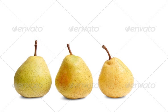 Ripe yellow pears on a white. - Stock Photo - Images