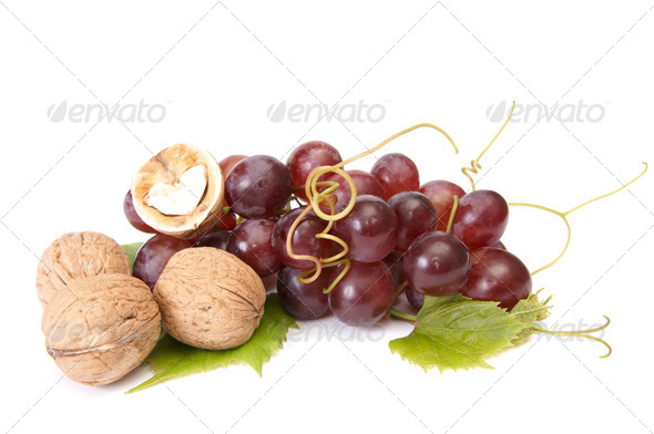 Tasty , ripe walnuts and grape isolated on a white background. - Stock Photo - Images