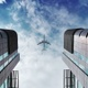 Plane Flies Close Above The Skyscraper Buildings In City - VideoHive Item for Sale