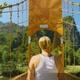 Woman Walking on Wood Suspension Bridge Walkway in the Mountains of Vang Vieng, Laos - VideoHive Item for Sale