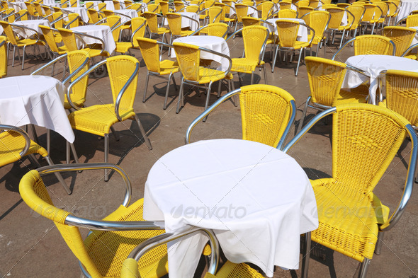 yellow chairs and tables cafe - Stock Photo - Images