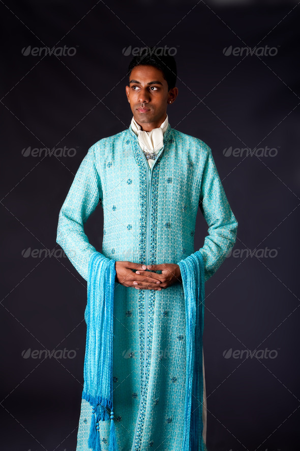 Indian groom wearing a Dhoti - Stock Photo - Images