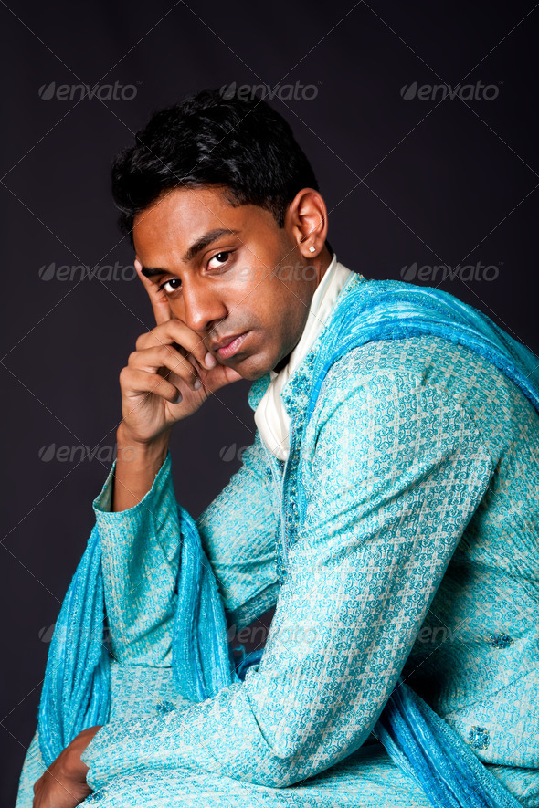 Hindu man sitting and thinking - Stock Photo - Images