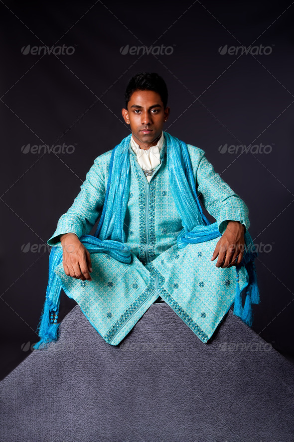 Hindu man sitting in lotus position - Stock Photo - Images