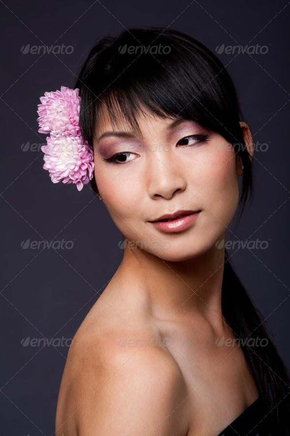 Face of Asian woman with flowers - Stock Photo - Images