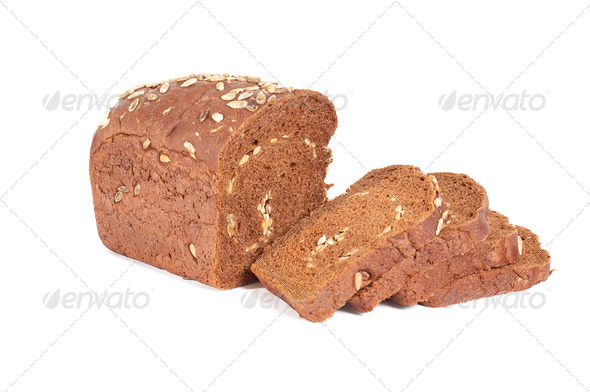Bread full of seeds  on a white background. - Stock Photo - Images