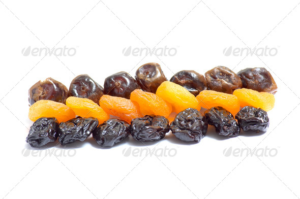 Composition from dried fruits on a light background. - Stock Photo - Images