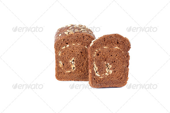 Rye bread full of seeds on a white background. - Stock Photo - Images
