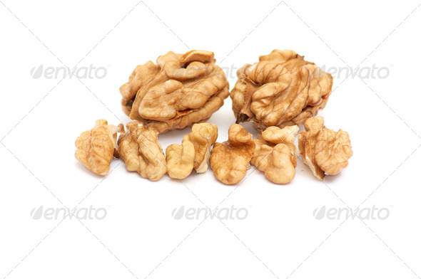 Pieces of walnuts on a white. - Stock Photo - Images