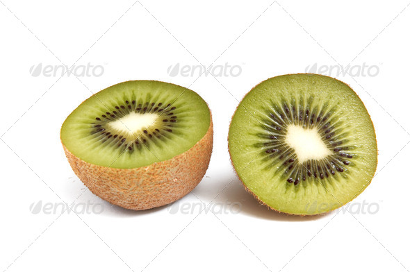 Pieces of kiwi  on white background. - Stock Photo - Images