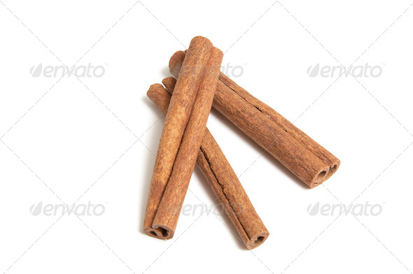 Aroma cinnamon sticks on a white background - Stock Photo - Images