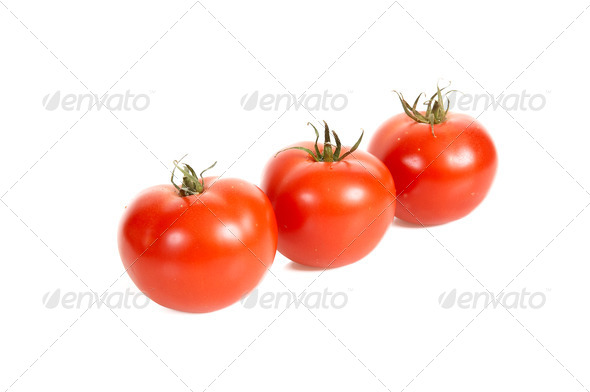 Three tomatos. - Stock Photo - Images