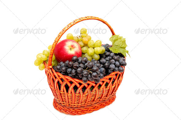 Bunches of grapes and apples in basket. - Stock Photo - Images