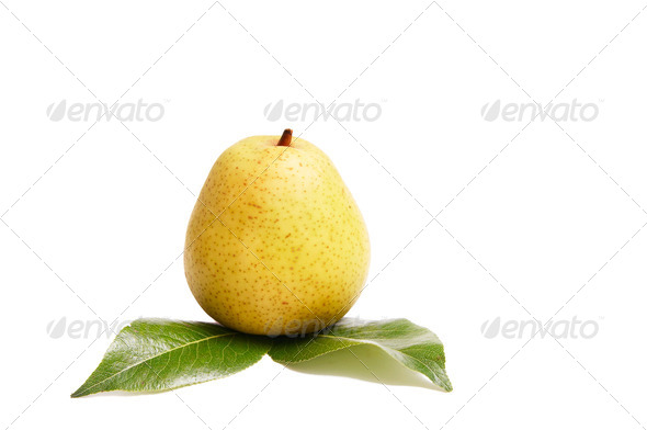 Juicy pear and green leaves on a white. - Stock Photo - Images