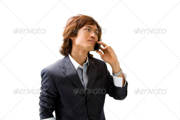 Asian business man and phone - Stock Photo - Images