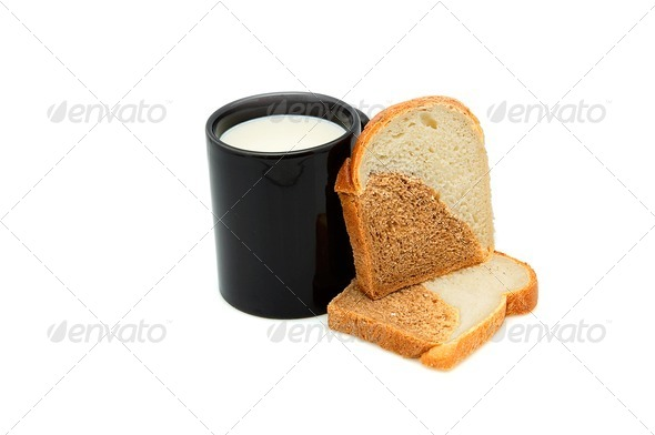 Cup of milk and bread. - Stock Photo - Images