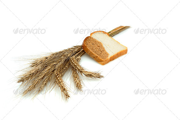 Spike and bit of bread. - Stock Photo - Images