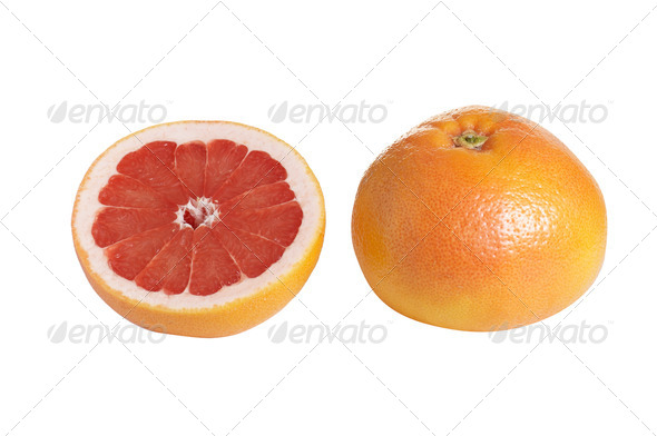 Whole and one piece of grapefruit on a white. - Stock Photo - Images