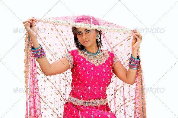 Beautiful Bangali bride lifting veil - Stock Photo - Images