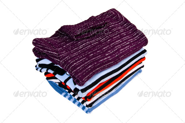 Comfortable colorful sweaters on a white. - Stock Photo - Images