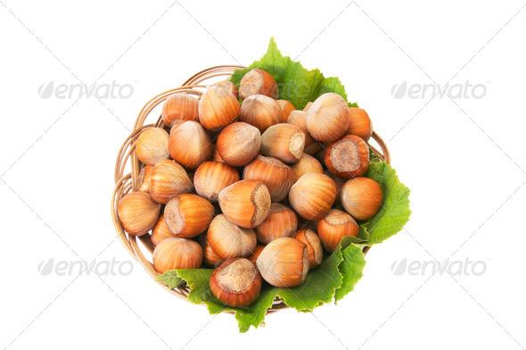 Ripe,tasty hazelnuts on a white. - Stock Photo - Images