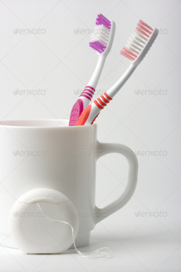 Two Toothbrushes In A Cup And Dental Floss - Stock Photo - Images