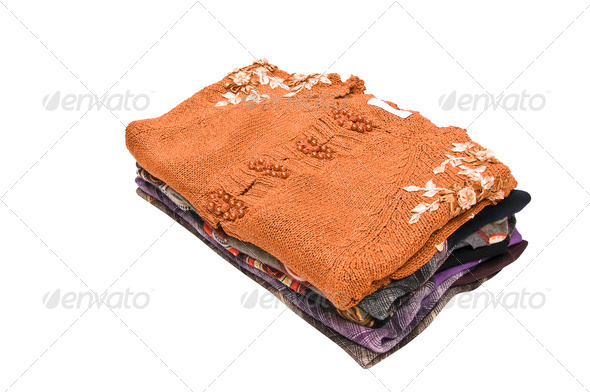 Stylish colorful sweaters and blouses on a white. - Stock Photo - Images