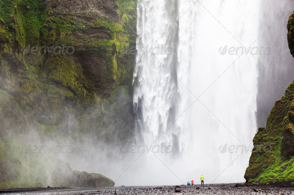 Tourists in front of Skogafoss waterfall - Stock Photo - Images