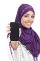 Muslim woman showing a blank smartphone screen - PhotoDune Item for Sale