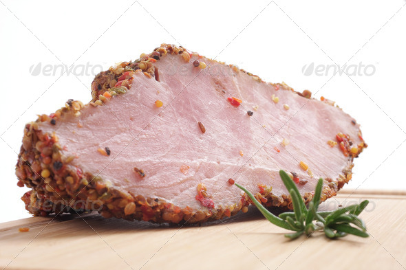 Smoked meat and rosemary on a board - Stock Photo - Images