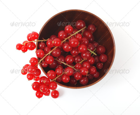 Red currant in a wooden cup on a white background - Stock Photo - Images