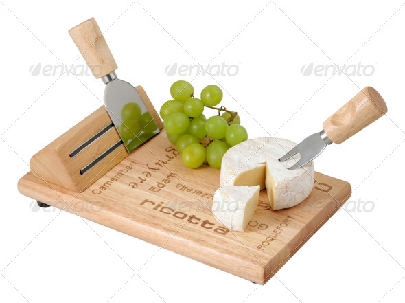 Cheese and grapes on a wooden board - Stock Photo - Images