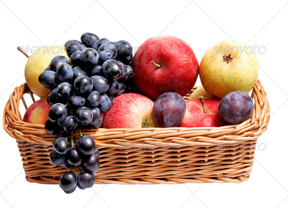 Ripe autumn fruits at the wooden basket. - Stock Photo - Images